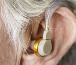 Elderly woman wearing a hearing aid